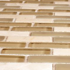 @Overstock - Glass and natural stone mosaic tile  Unglazed textured finish with a high/low sheen and a uniform to moderate variation in tone  Easy to install 11.75 inches x 11.75 inches x 0.31 inch mesh mounted tileshttp://www.overstock.com/Home-Garden/SomerTile-12x12-in-Reflections-Subway-5-8x2-in-Sandstone-Glass-Stone-Mosaic-Tile-Pack-of-10/4511716/product.html?CID=214117 $136.55 mosaic tile