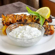Chicken Souvlaki with Lemon Mint Tzatziki - try this favorite summertime grill recipe on a grill pan or under your broiler to add a burst of flavor to a boring winter menu. I've included a link to my homemade flatbread to serve with it or for amazing wraps too.