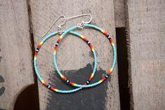 """Beaded hoop earrings """"seed bead hoop earrings   each pair is made by hand   beautiful turquoise, yellow, coral, black seed beads   2 inch hoop - sterling silver earwires"""""""