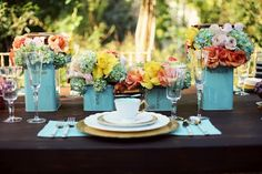 Metal tins are plentiful at thrift stores or yard sales. I love the idea of spray painting them the same color -- or similar hue -- and using them for floral centerpieces.