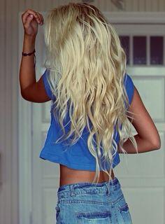 Long blonde hair. Tan skin.