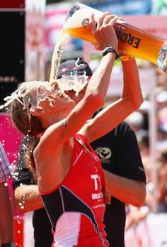 Chrissie Wellington.. undefeated in Ironman distance.. her celebrating after winning Challenge Roth