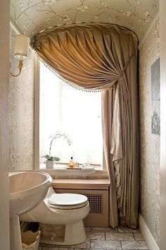 Charming little bathroom. Yards and yards of fabric!