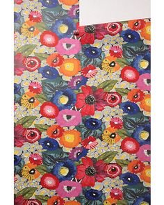 We're loving this colorful poppy wallpaper! Get it here: www.bhg.com/...
