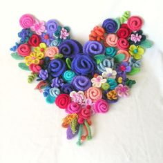 felted posies on a heart-so pretty & colorful!