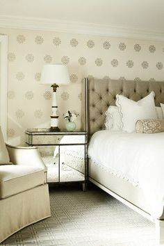 I love that wall paper!!! And that headboard!