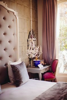 Headboard - tufted and framed, drapes, pillow, bed, chandelier