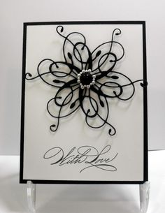 handmade card ... black and white ... delicate die cut flower flourish with a lovely ring of pearls in the center ... sentiment also full of swirls ...
