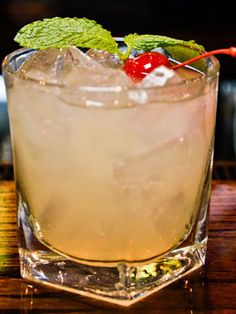 Millionaire Mojito (1½ oz. Bacardi Rum Torched Cherry ¼ of lime ¼ oz. agave nectar 5 mint leaves Garnish: mint sprig and maraschino cherry)