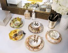 earrings stored in vintage teacups