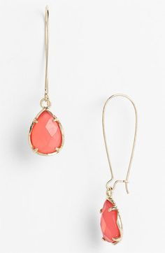 Coral and gold earrings.