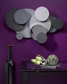 Contemporary wall sculpture appears to be made from textured metal discs, but this stunning and lightweight wall art is made from STYROFOAM™ brand foam and textured paper.