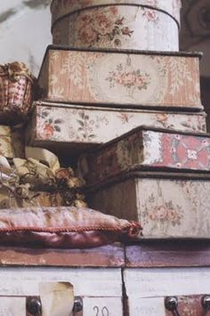 beautiful old fabric covered boxes...