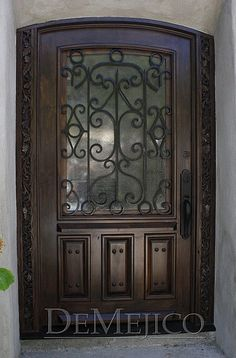 Custom Mahogany Entry Door with a custom carved jamb and features a Hinged glass door
