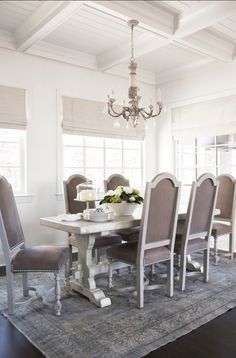 velvet upholstered, painted dining chairs with nickel nailhead trim.