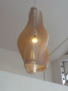 """Clove Lamp"". Laser-cut plywood at a boutique on Valencia. Can't find any info online."