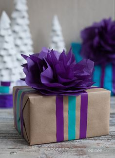 Tissue Paper Flower Topper - A pretty DIY Christmas gift topper you can make in minutes.