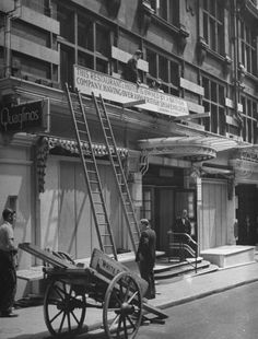 London at War - 1940 Quaglino's In Bury Street St James erects signs to protect it from Anti-Italian Riots.