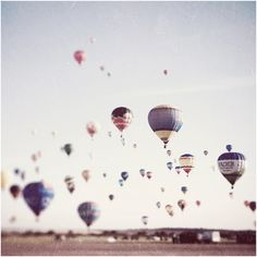 someday photograph hot air balloons taking off, so beautiful with the sunrise behind them.