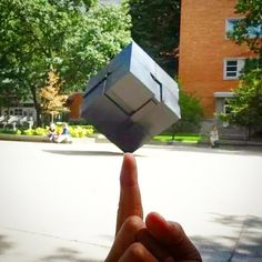 This new student gave the Cube a spin for his first time on #umich campus!