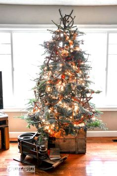 7 garland twigged out Christmas tree in a crate via http://www.funkyjunkinteriors.net/