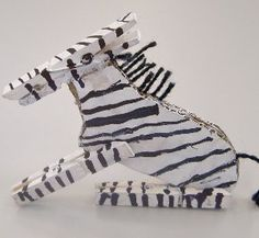 Take a journey to the African savannah! These Cardboard Zebra Puppets can be posed and repositioned for easy playtime. Homemade toys like these amazing animal crafts for kids teach children about nature and allow them to have fun too!