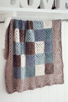 Great colors.  Granny square crochet afghan.