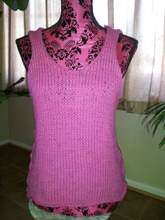 a hot pink knitted tank top.