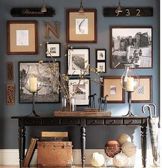 Love the wall color, black and wood frames and burlap.