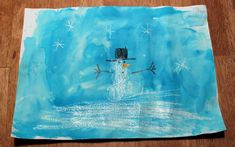 Winter themed crayon resist drawings featuring white crayons