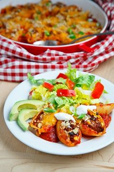 Taco Stuffed Shells, maybe with enchilada sauce? Yum!