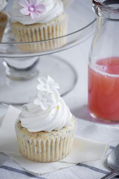 Grapefruit poppy seed cupcakes with strawberry rhubarb jam and cream cheese Swiss meringue buttercream.