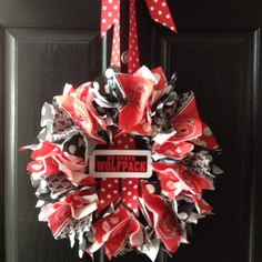 NC State wreath made from napkins.  I used NC State (half NC State symbol & half wolf design) plus red & black polka dot napkins on a green floral ring wrapped with red crepe paper.