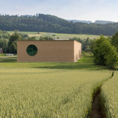 Herzog and de Meuron uses rammed earth to create countryside herb centre for Ricola.