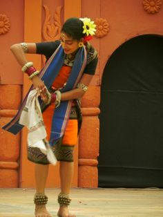 An Artist performing Sambalpuri Dance Form of Odisha (Orrisa).    One of the must attend events for cultural immersions in Delhi is the annual Surajkund Craft Fair. Held everyyear in Febrauary at Surajkund, Faridabad.