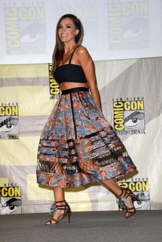 At Comic-Con International in San Diego, Jessica Alba teamed a Tanya Taylor bandeau top with a printed Zimmermann skirt. [Photo by Albert L. Ortega/Getty Images]