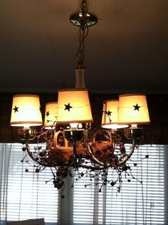 shades $1 each and a wire star garland cut to fit each shade for my table light. Less than $2 to  fix per shade...love it..