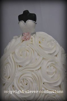 Another wedding gown cake, buttercream with fondant bodice; rhinestone accents for added bling!  A perfect bridal shower cake!