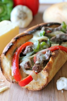 Philly Cheesesteak with Garlic Aioli ~ You could easily make this right at home without having to skimp on the cheesy, meaty goodness!