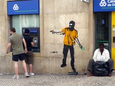 """Banksy """"Hold Up"""" at an ATM in Lisbon, Portugal"""