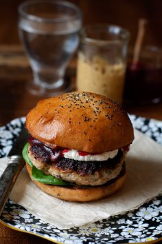 Love the delightful flavours at work in this filling turkey burger with tangy cranberry sauce and silky goat cheese. #turkey #burger #hamburger #sandwich #cranberry #sauce #cheese #food #dinner #lunch #cooking #Christmas #Thanksgiving
