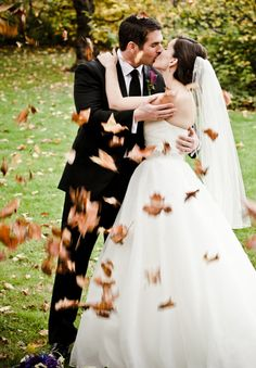 Every couple should be showered with autumn leaves!