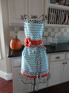 I LOVE this apron! Plus, it would match my kitchen... :) These ladies are so talented!  4RetroSisters BlackEyedSusan  Coastal Fall Apron  by 4RetroSisters, $37.50