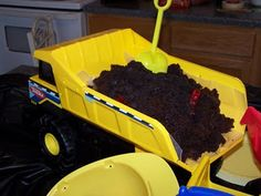 Dirt cake with gummy worms in the (plastic-lined) back of a Tonka truck.