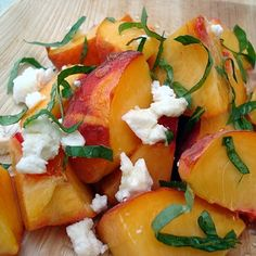 Fresh Peach and Basil Salad  Ingredients        * 4-6 ripe peaches, pitted and cut into bite-size pieces      * 1 Tb. honey      * 4-6 basil leaves, thinly sliced      * ½ cup lemon chevre (or plain chevre with a little lemon zest)      * A pinch of salt