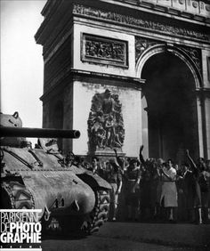 Parisians welcome Allied tanks into the city after its liberation. August 26, 1944.