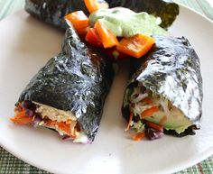 #Vegan Sushi Rolls made with hummus, shredded carrots and cabbage, avocado, and onion. #whatveganseat