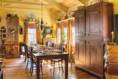 The Match Game: An Indiana couple play Connect the Logs to join two old cabins with a newer building to create one great home that they love to share with others. (Photographed by Bill Mathews, styled by Gloria Gale)