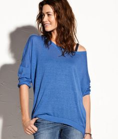 I want a big sweater like this...and some skinny jeans to wear it with so I don't look like a slob!