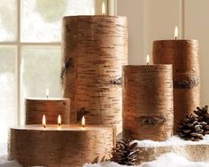 hand-poured wax candles covered in real birch bark